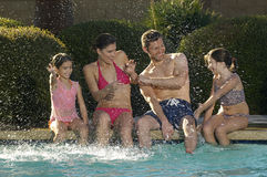 Family Having Fun At Swimming Pool Royalty Free Stock Photo