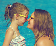Family having fun in swimming pool. Mother and her daughter having fun in swimming pool Stock Images