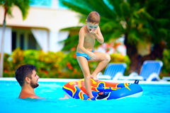 Family having fun in swimming pool, summer vacation. Excited family having fun in swimming pool, summer vacation Stock Images