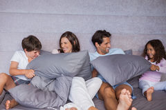 Family having fun together on bed Stock Image