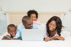 Family having fun together in bed Stock Image