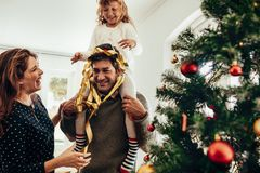 Family having fun together on Christmas. Royalty Free Stock Photos