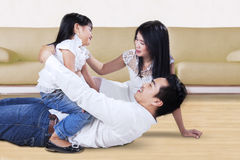 Family having fun together on the floor Stock Images