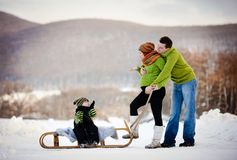 Family having fun together outside in winter Stock Photo