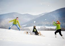 Family having fun together outside in winter Royalty Free Stock Image