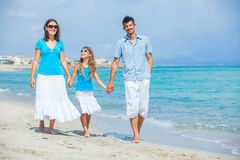 Family having fun on tropical beach Stock Photos