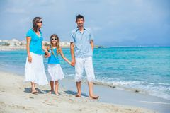 Family having fun on tropical beach Stock Images
