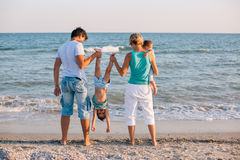 Family having fun on tropical beach Royalty Free Stock Image