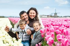 Family having fun on tulips field Royalty Free Stock Photography