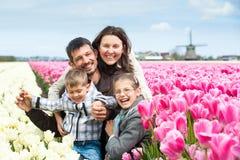 Family having fun on tulips field Royalty Free Stock Photography