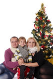 Family having fun under Christmas tree Royalty Free Stock Photography