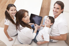 Family Having Fun Using Tablet Computer At Home Stock Photos