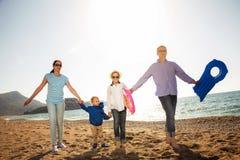 Family Having Fun Walking on Beach Royalty Free Stock Photography