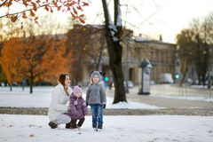 Family having fun at winter city Stock Image