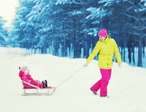 Family having fun in the winter Stock Images
