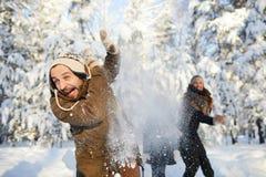 Family Having Fun in Winter Park royalty free stock image