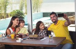 Family having great time in a restaurant, make selfie photo Stock Photo
