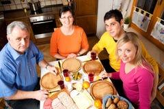 Family having hearty dinner stock photography