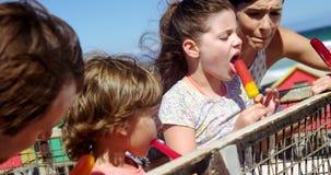 Family having ice cream at beach stock video footage