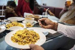 Family having Indian food together stock images