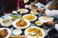 Family having Indian food together stock photos
