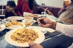 Family having Indian food together royalty free stock photo