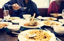 Family having Indian food together stock image