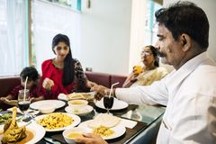 Family having Indian food together royalty free stock images