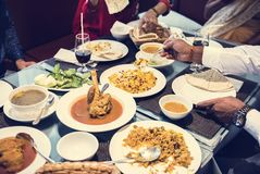 Family having Indian food together royalty free stock image