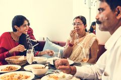 Family having Indian food together at restaurant Stock Images