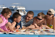 Family having lunch on beach Stock Photography