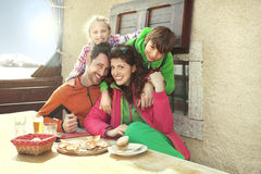 Family having lunch in a chalet in mountain. Happy family having lunch in a chalet in mountain stock photo