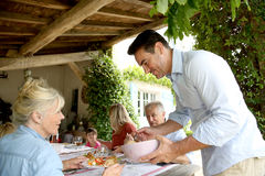 Family having lunch in countryhouse Royalty Free Stock Photo