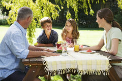 Family having lunch in the garden Royalty Free Stock Images