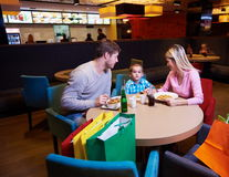 Family having lunch in shopping mall Stock Photo