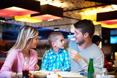 Family having lunch in shopping mall Royalty Free Stock Image