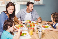 Family having lunch while sitting at dining table Royalty Free Stock Photos