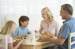 Family Having Meal At Dining Table royalty free stock images