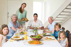 Family having meal at dining table royalty free stock photo