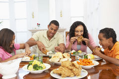 Family Having A Meal At Home Stock Images