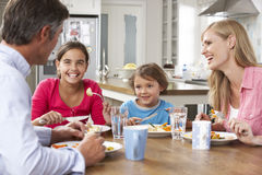 Family Having Meal In Kitchen Together stock photography