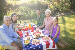 Family having meal in the park on a sunny day. Happy family having meal in the park on a sunny day Stock Images