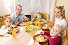 Family having a meal together Stock Images