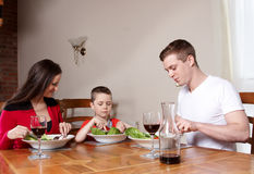 A family having a meal together Stock Photography