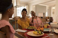 Family having meal together on dining table. Front view of a happy African American family having meal together on dining table at home royalty free stock photo
