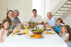 Family having meal together at dining table Royalty Free Stock Photos