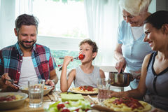 Family having meal together. At home Stock Images