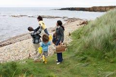 Family having picnic. At the beach royalty free stock photo
