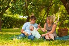 Family having picnic. In park Stock Photo