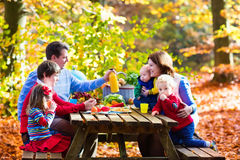 Family having picnic in autumn Royalty Free Stock Photography